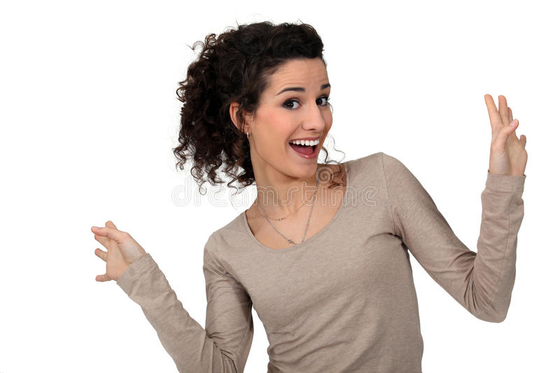 Woman dancing with joy stock photography