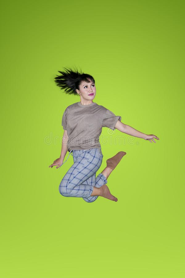 Woman dancing and jumping with casual clothes royalty free stock photo