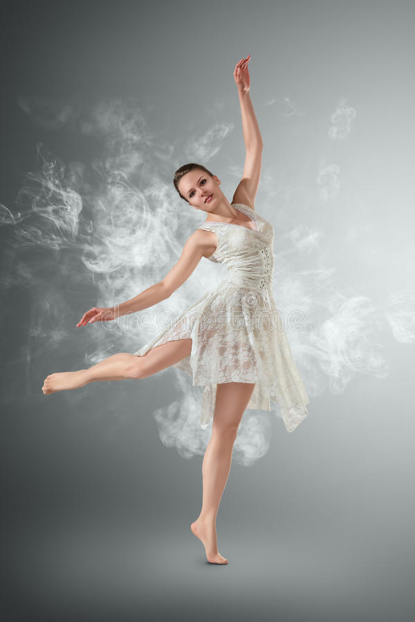 Woman dancing over smoky royalty free stock photo