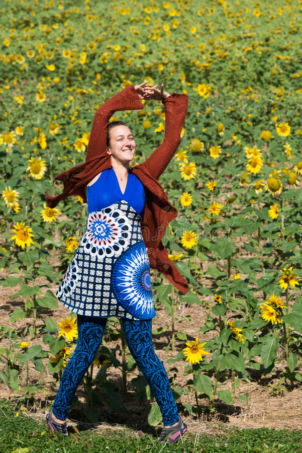 Woman Dancing solo in Field of Sunflowers royalty free stock photo