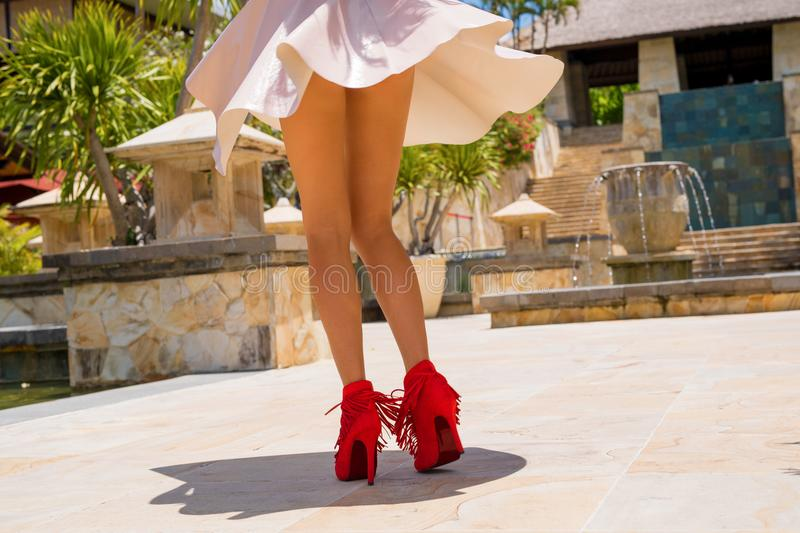 Woman dancing on the street in high heels royalty free stock photo