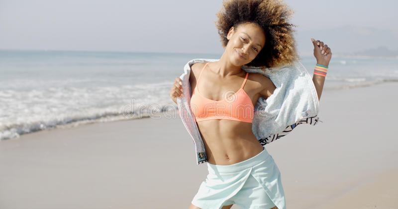 Woman Dancing On The Tropical Beach. Africam american woman dancing on the tropical beach slow motion stock images