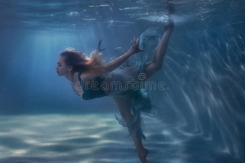 Woman dancing in the underwater. stock images