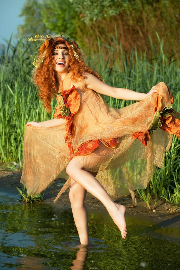 Woman dancing in the water. stock photo
