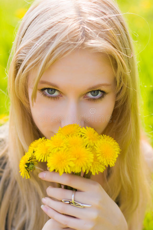Woman with dandelions stock images