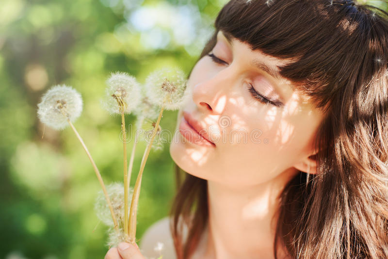 Woman with dandelions stock photos