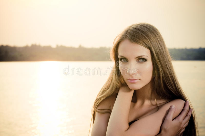 Woman in dark dress in the beach royalty free stock image