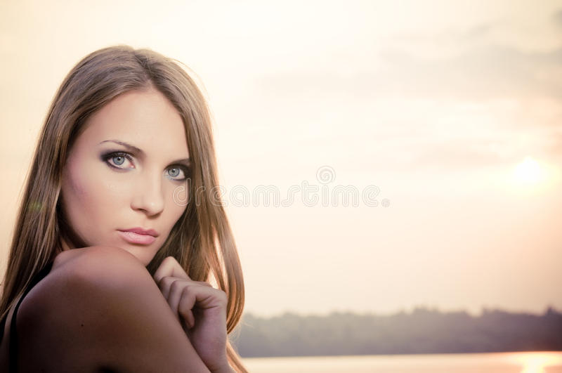 Woman in dark dress in the beach royalty free stock photo