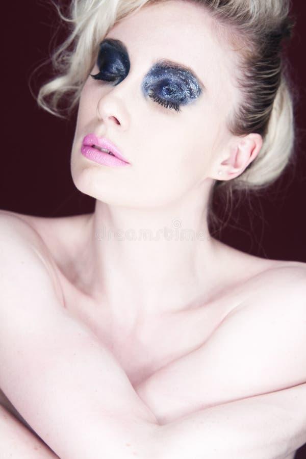Woman With Dark Eye Makeup Royalty Free Stock Image