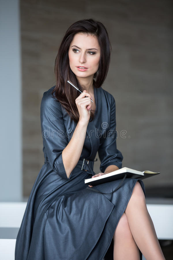 Woman in a dark gray dress royalty free stock images