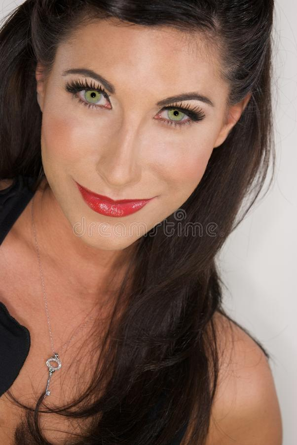 Woman with Dark Hair and Green Eyes stock images