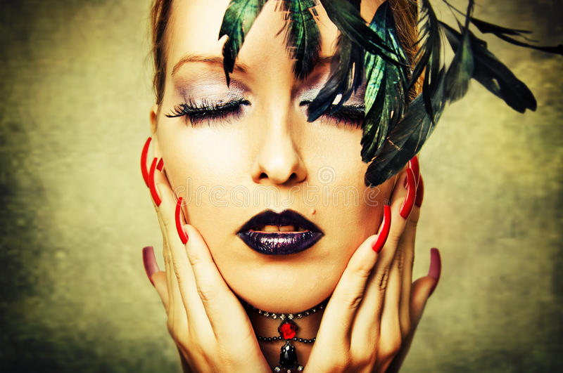 Woman with dark makeup and red nails royalty free stock photos