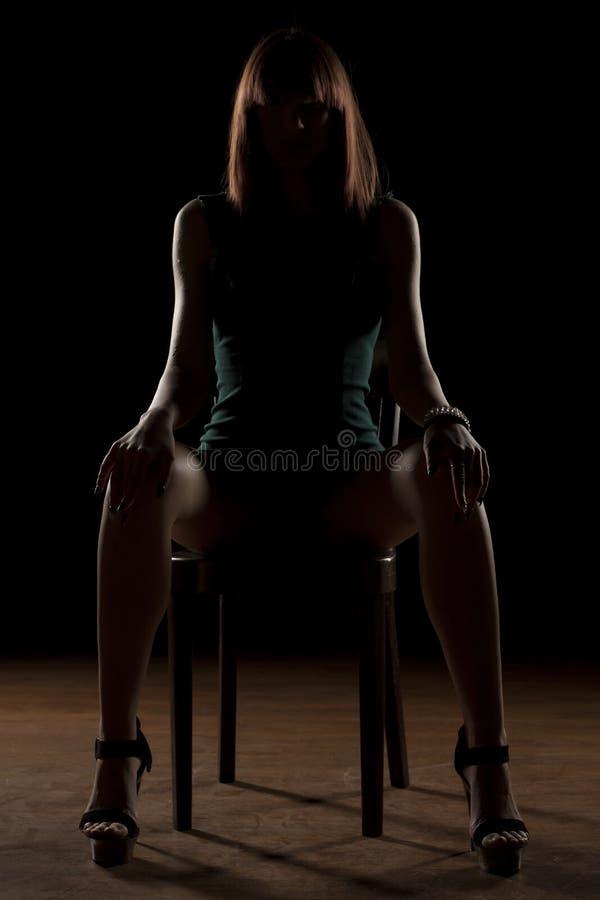 Woman in the dark stock photos