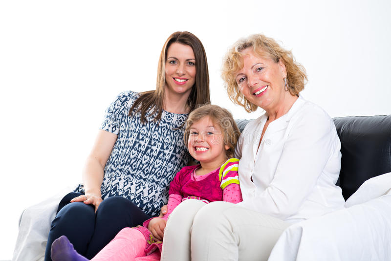 Woman with daughter and grandchild in front of white background royalty free stock photos