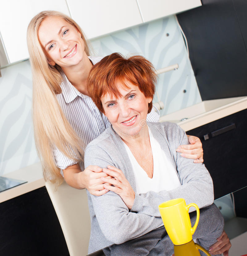 Download Woman With Daughter On Kitchen Royalty Free Stock Image - Image: 30539736