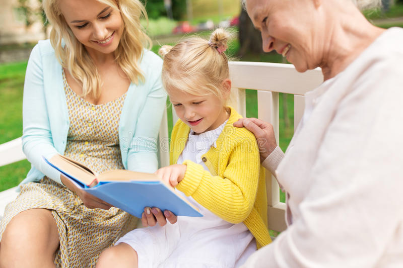 Woman with daughter and senior mother at park royalty free stock image