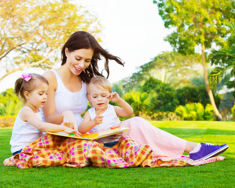 Woman with daughter and son read fairytale royalty free stock image