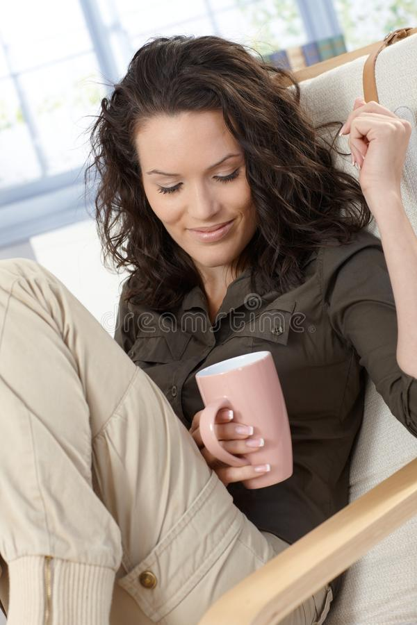 Woman Daydreaming With Cup Of Tea Stock Photo