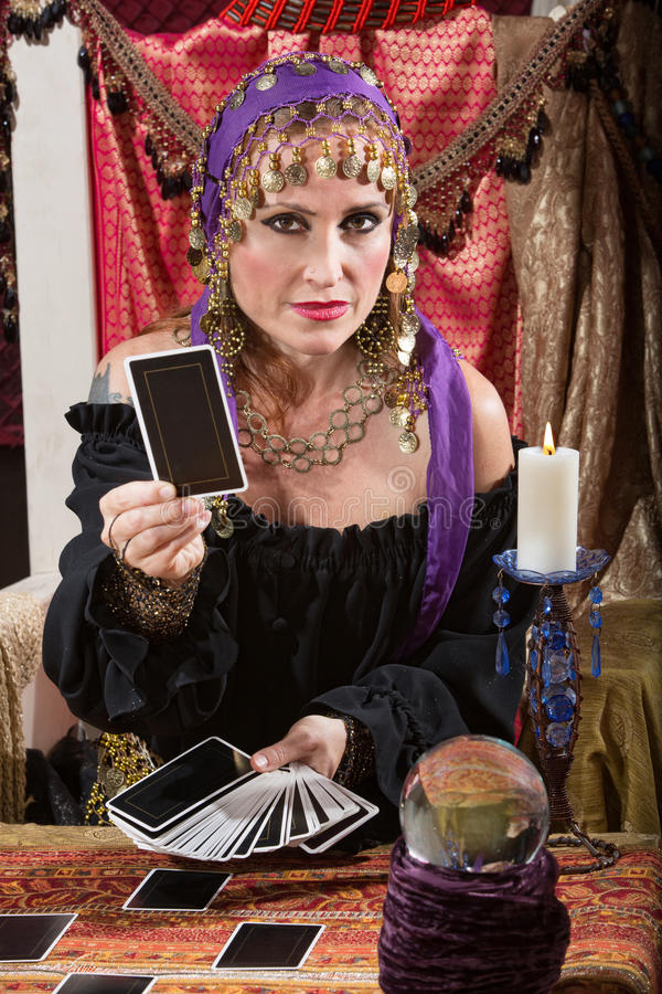 Woman Dealing Tarot Cards Stock Image. Image Of Indoors