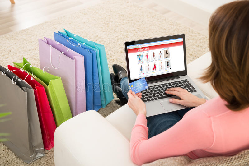 Woman With Debit Card Shopping Online stock photography
