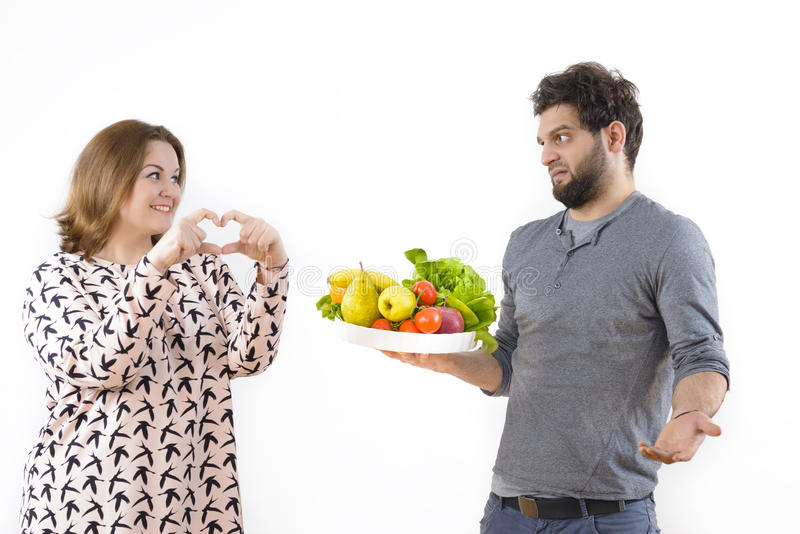 Woman Declaring Love to her Boyfriend. But he constrain her to lose weight royalty free stock photos