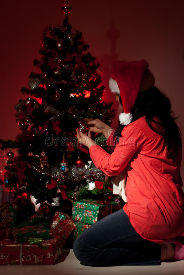 Download Woman Decorate Christmas Tree In Night Stock Photo - Image: 17536894
