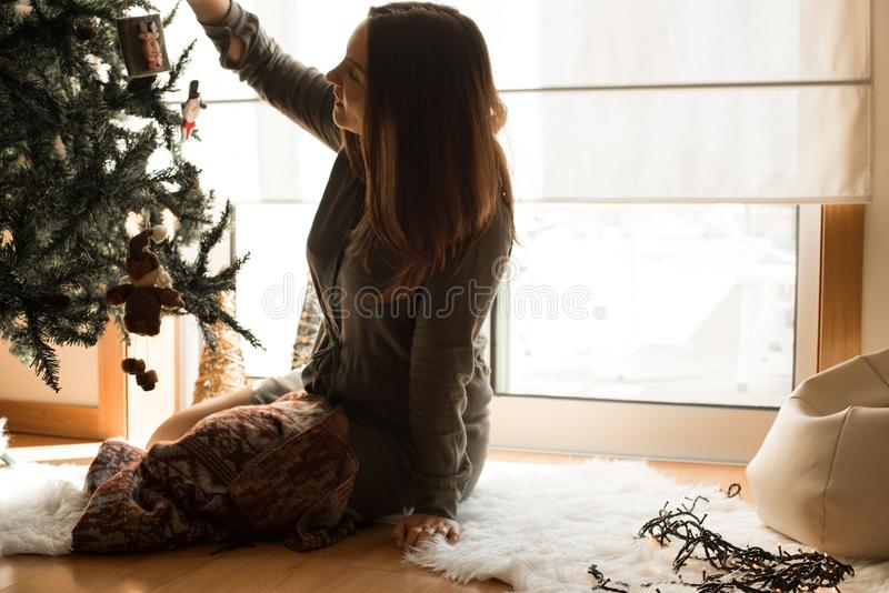 Woman decorating Christmas tree stock photography