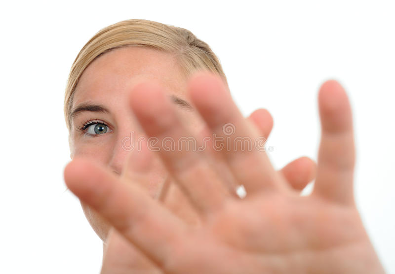 Woman defensive. Defensive woman holding hands to protect against something stock images