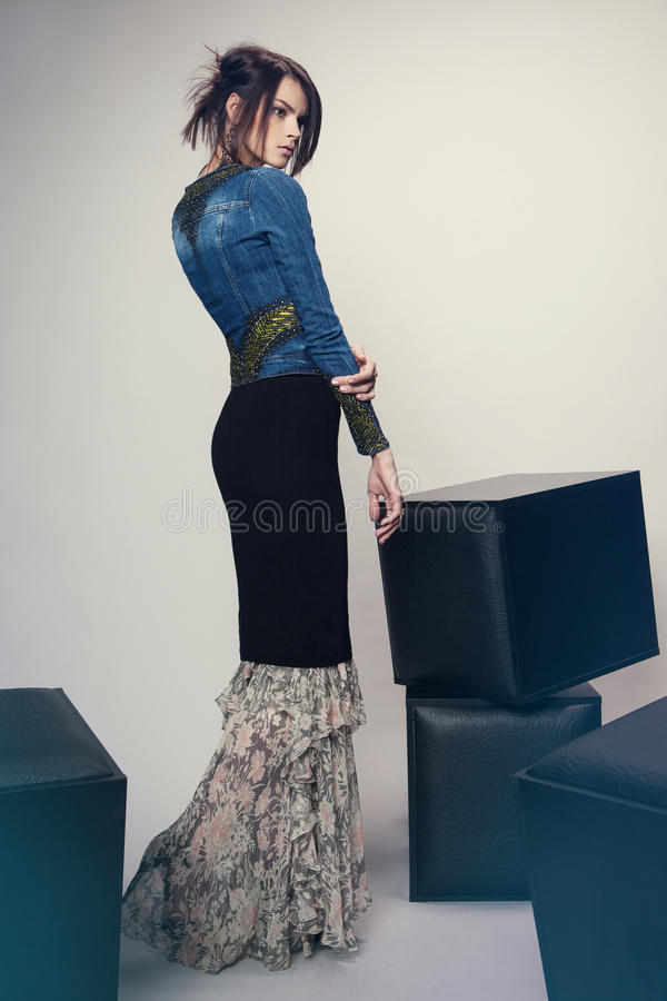 Woman in denim jacket and long dress stock photos