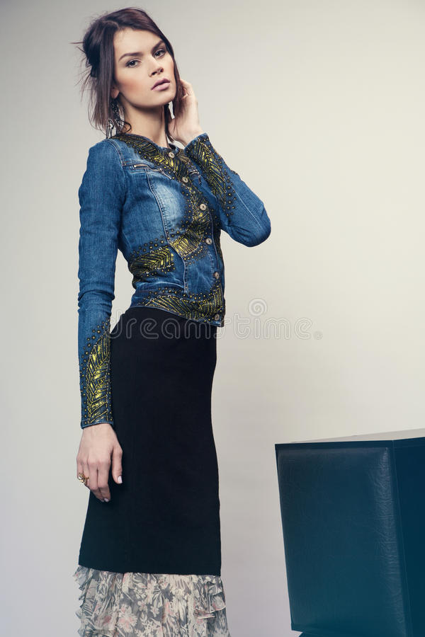 Woman in denim jacket and long dress stock images
