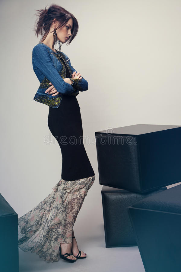 Woman in denim jacket and long dress royalty free stock photos