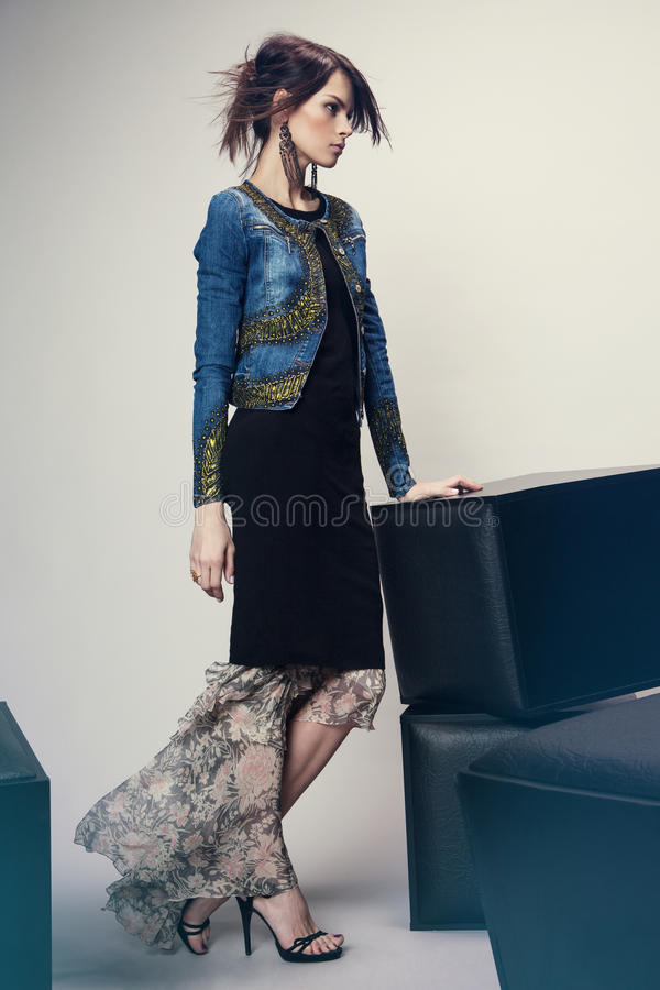 Woman in denim jacket and long dress royalty free stock photo