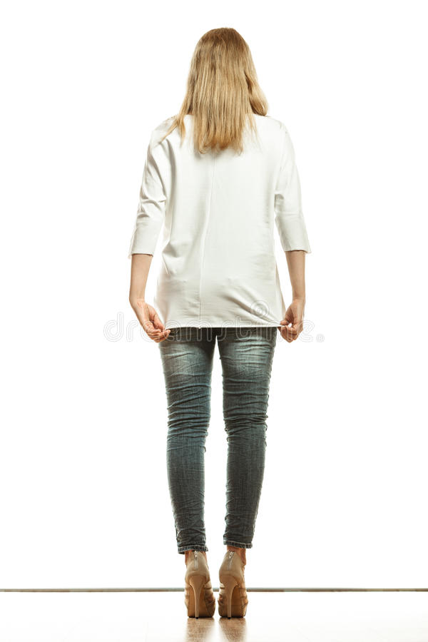 Woman in denim pants white blank top back view royalty free stock images