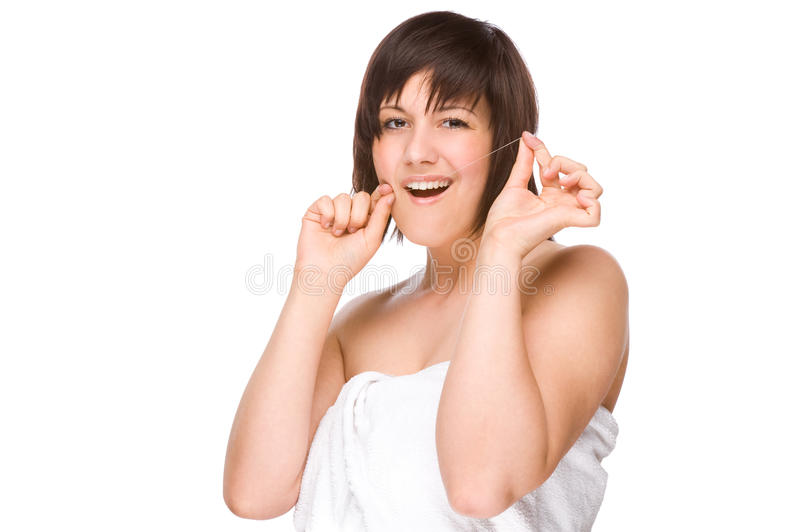Woman with dental floss royalty free stock photography