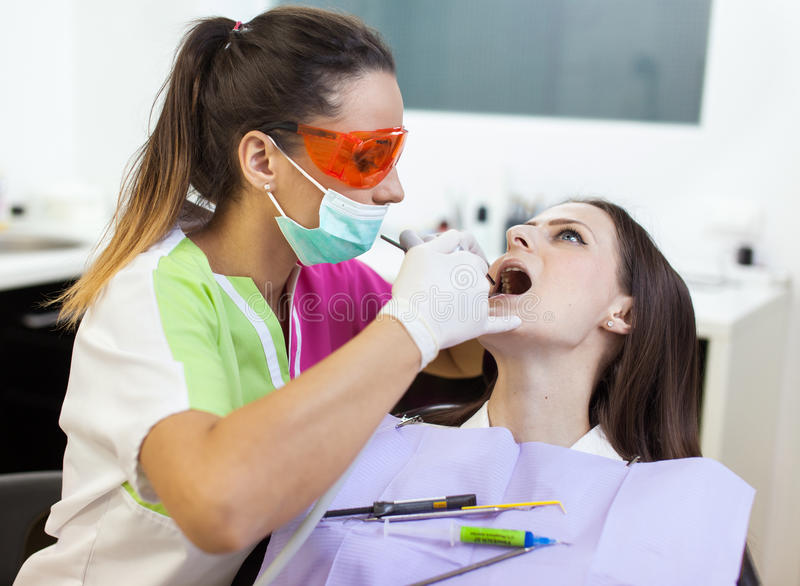 Download Woman Dentist Checking Her Patient's Teeth Stock Photo - Image: 39405390
