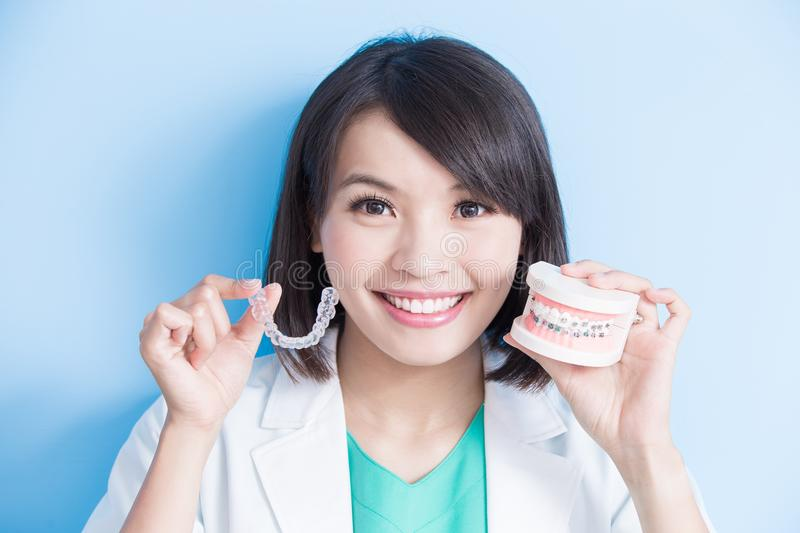 Woman dentist take brace stock photos