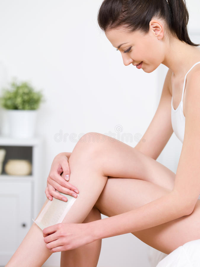 Download Woman Depilating Her Legs By Waxing Stock Image - Image: 15089965