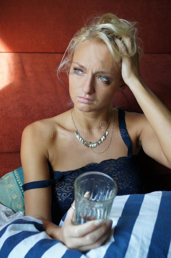 Woman Depressed. Hangover royalty free stock image