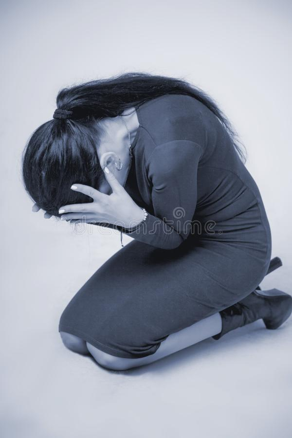 Woman in depression alone with problems difficulties, psycholo. Gy, body language, gestures, loneliness concept stock photo