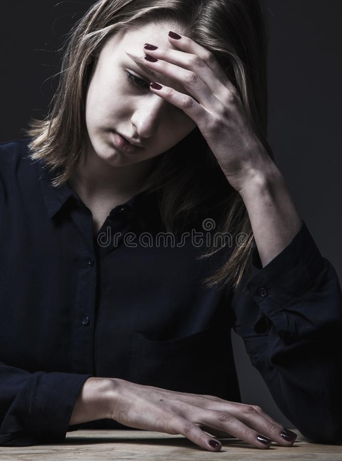 Woman in depression alone with problems difficulties, psycholo stock images