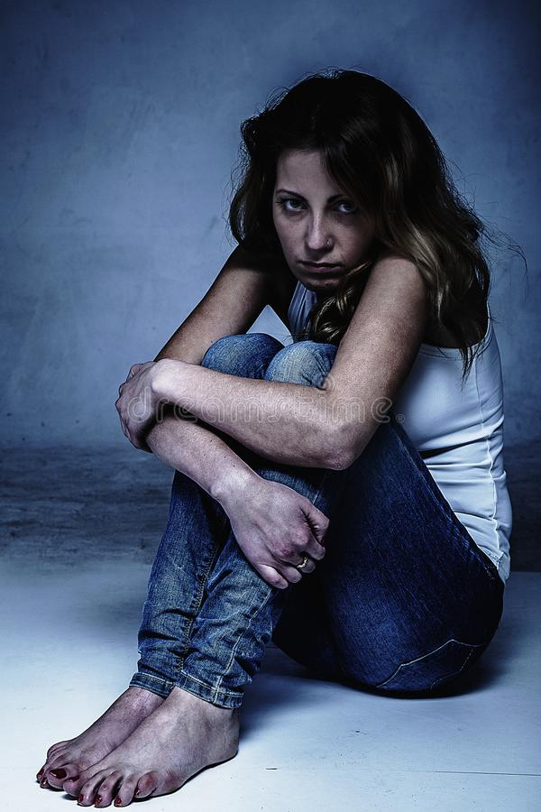 Woman in depression alone with problems. Portrait of woman on a stock image