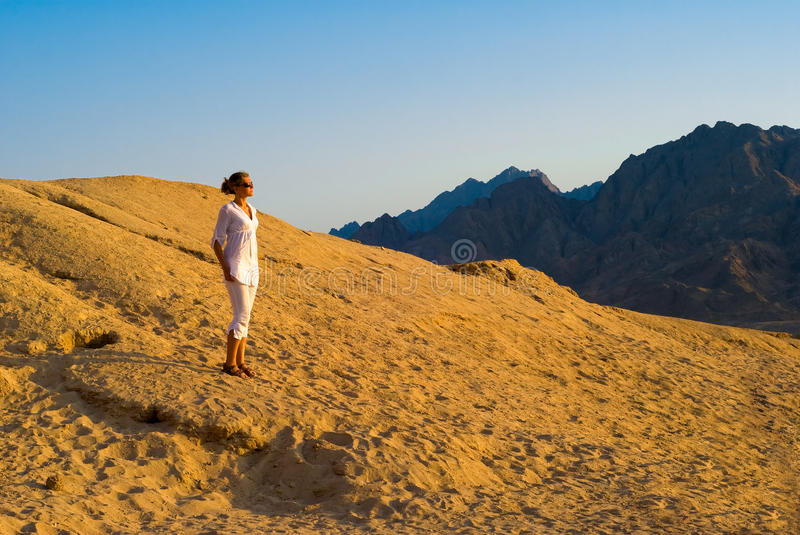 Download Woman in the desert stock photo. Image of cliff, nature - 12496944