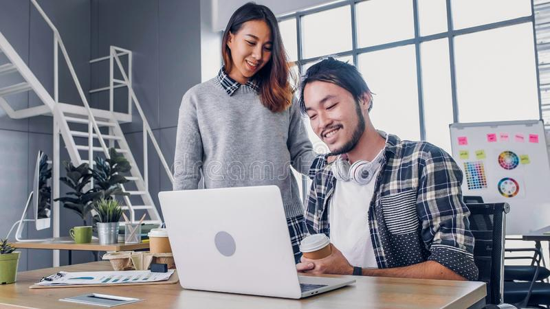 Woman designer buy coffee cup to colleague at modern office in morning at desk.casual workplace lifestyle.  stock image