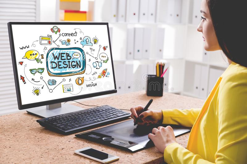 Woman designer drawing a web design sketch royalty free stock photography