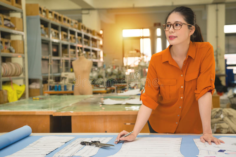 Woman designer standing in the work desk royalty free stock images