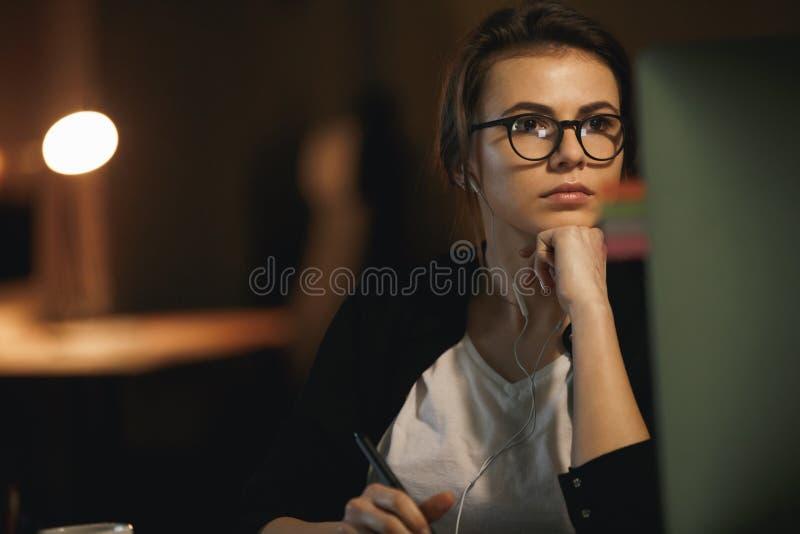 Woman designer using computer stock image