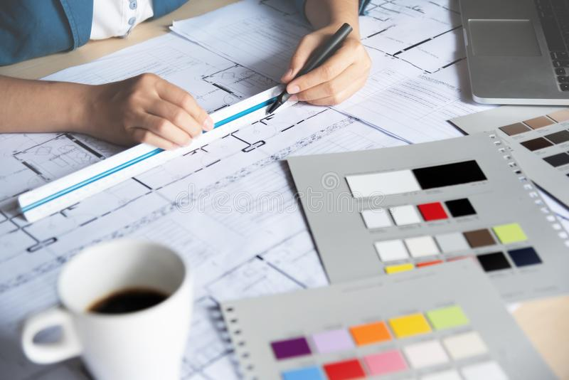 Woman Designer working with sketching. royalty free stock photo