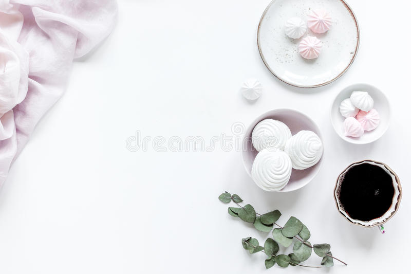 Woman desk with plant, coffee and marsh-mallow in spring desing on white background flat lay mock-up royalty free stock image