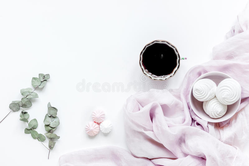 Woman desk with plant, coffee and marsh-mallow in spring desing on white background flat lay mock-up stock image