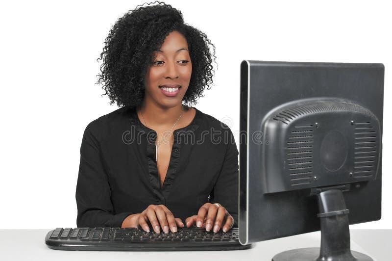 Woman on desktop computer stock photo